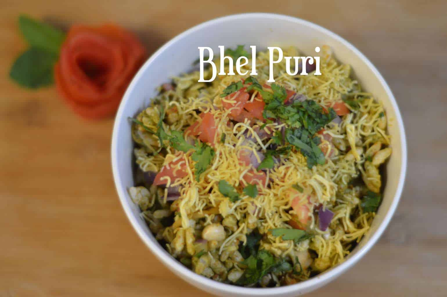 Bhel Puri Chaat Recipe is one of the most popular chaat's made of puffed rice, vegetables, green chutney , tangy tamarind sauce and few spices.