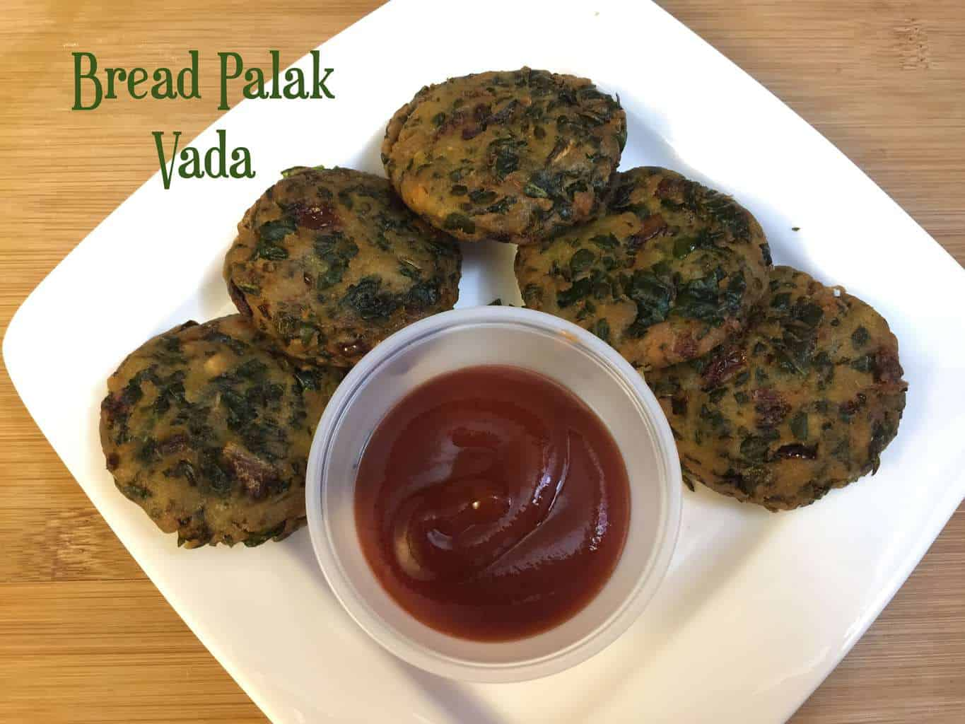 Bread Palak Vada Recipe served on a plate with tomato ketchup on the side