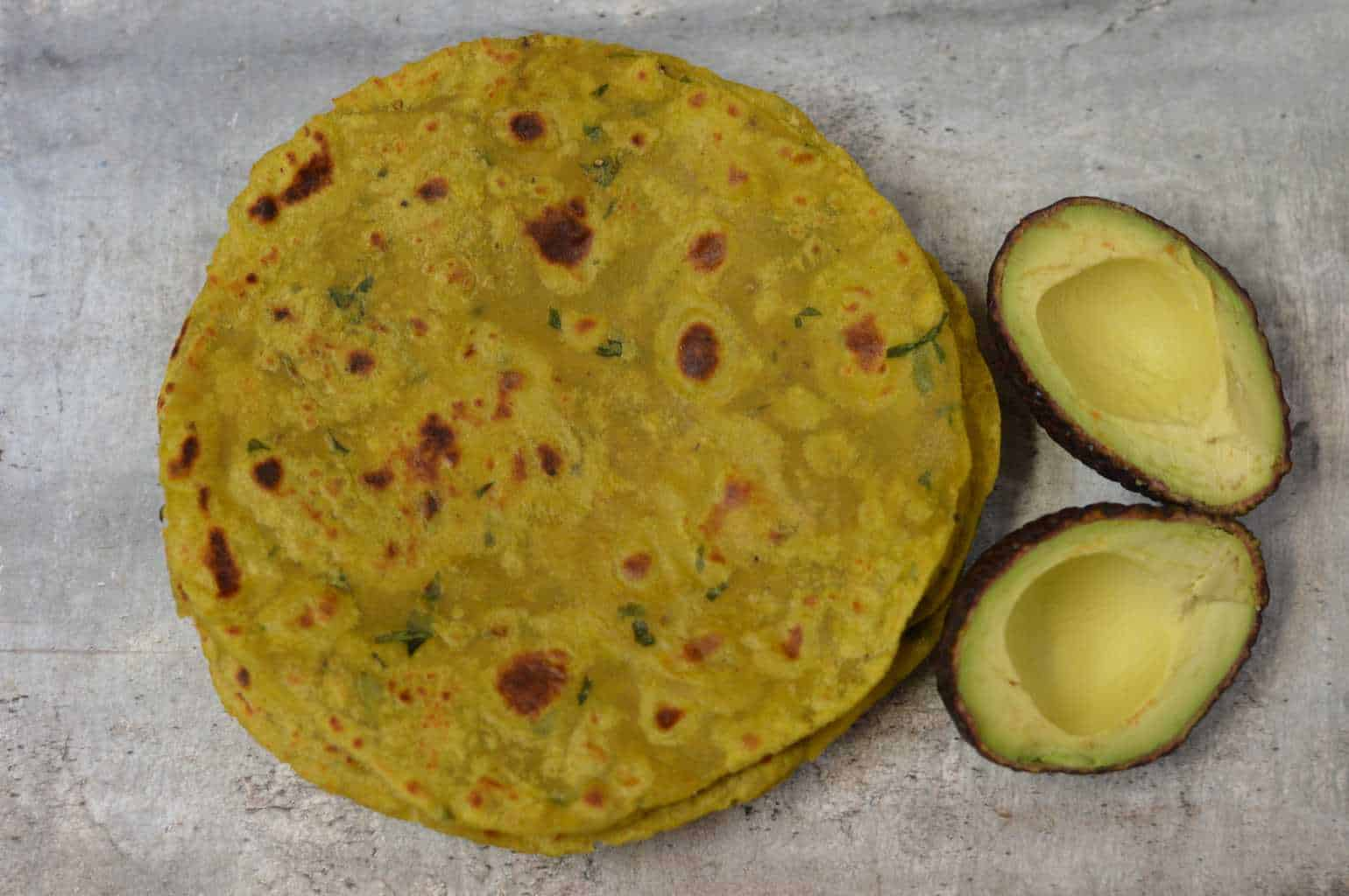 Avocado Parathas|Avocado Paratha is an Indian Whole Wheat Flatbread prepared by kneading whole wheat flour and avocado pulp together with few spices|indianveggiedelight.com