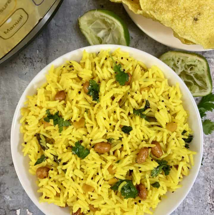 Lemon rice is a simple tangy flavored South Indian rice dish which is prepared with lemon juice, peanuts, and spices