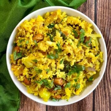 Cauliflower Poha served in a white bowl