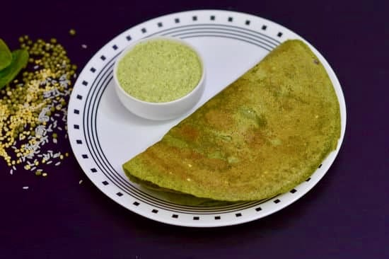 Palak Moong Dal Dosa|Palak Pesarattu is a no fermentation healthy dosa recipe made from ground whole green gram, split green gram, spinach, rice, ginger, cumin and chillies