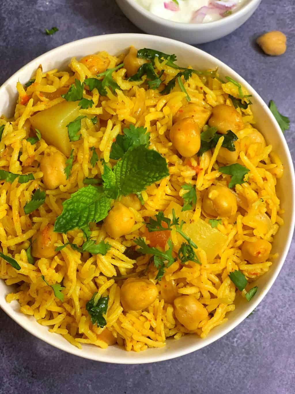 Instant Pot Chole Biryani|Chickpea Biryani|Garbanzo Beans Biryani is a delicious and healthy variation for vegetable biryani.Its a one-pot dish and can be made in less than 30 minutes.Its a great potluck or lunch box option for adults.
