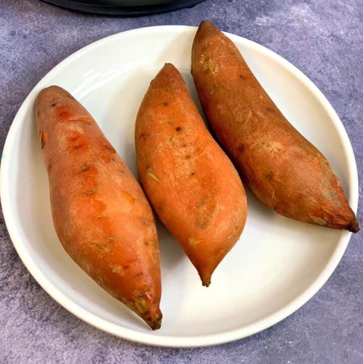 instant pot boiled sweet potatoes on a white plate