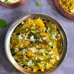 Tendli Masale bhaat in a copper bowl with raita on side