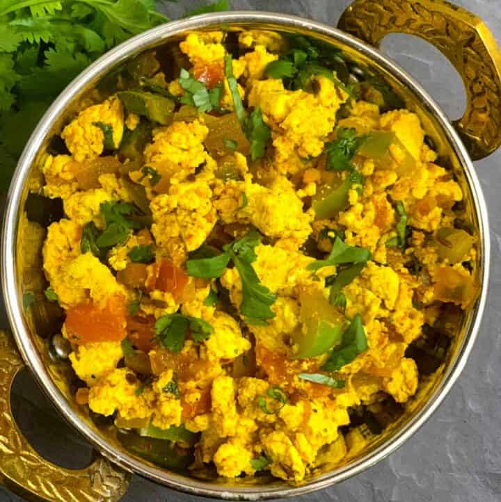 Indian Style Tofu scramble served in a kadai garnished with cilantro